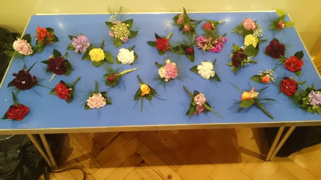 Our buttonholes.